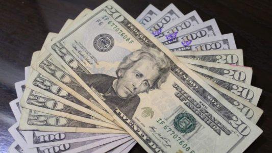 Pile of twenty and hundred dollar bills
