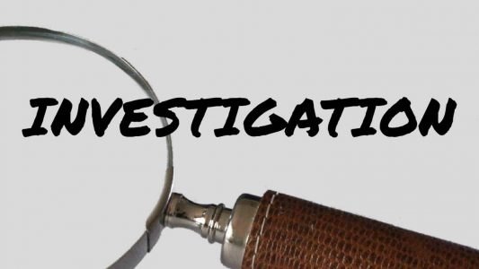Magnifying glass half over the word INVESTIGATION overlain on white rectangle