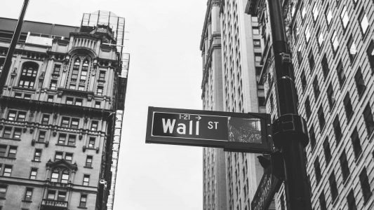 Wall Street Sign and Buildings